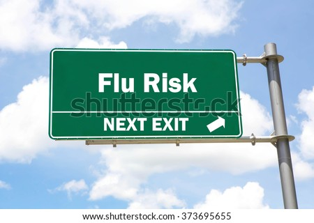 Green overhead road sign with a Flu Risk Next Exit concept against a partly cloudy sky background. - stock photo