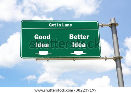 Green overhead road sign with the instruction to get in lane with a Good Idea or Better Idea concept against a partly cloudy sky background. - stock photo