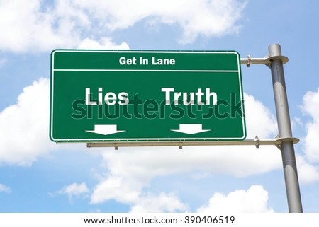 Green overhead road sign with the instruction to get in lane with a Lies Or Truth concept against a partly cloudy sky background. - stock photo