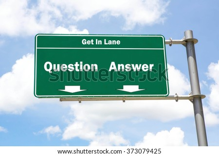 Green overhead road sign with the instruction to get in lane with a Question or Answer concept against a partly cloudy sky background. - stock photo