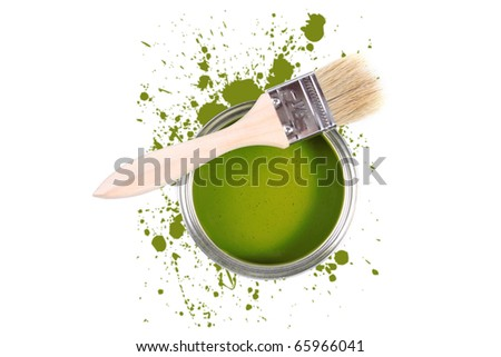 green paint can with brush and color stains - stock photo