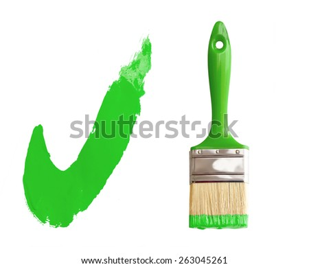 green paintbrush isolated on white with painted check mark