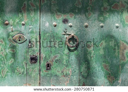green painted door with lock and handle in round shape