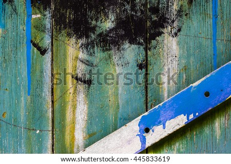 Green painted natural wood background texture. Closeup