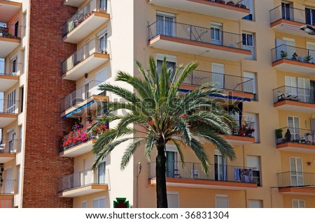 Green palm, hotel and luxury apartments in Lloret de Mar, Spain.