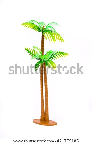 Green palm of the children's playground on a white background