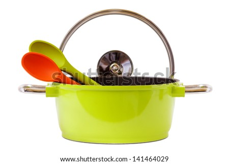 Green Pan and Kitchen Utensil isolated on white - stock photo