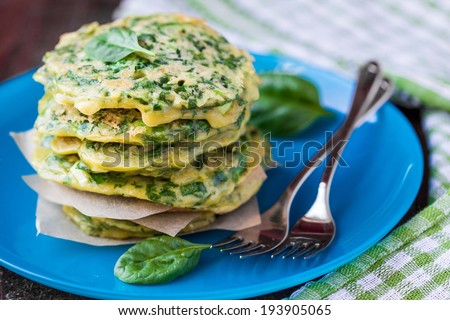 Green pancakes with herbs parsley, spinach, onions, delicious summer snack, spring breakfast - stock photo
