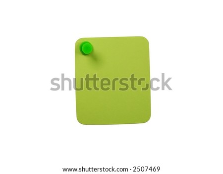 Green paper affixed to a white background with a green pushpin. - stock photo