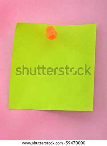 Green paper and push nail on purple background - stock photo