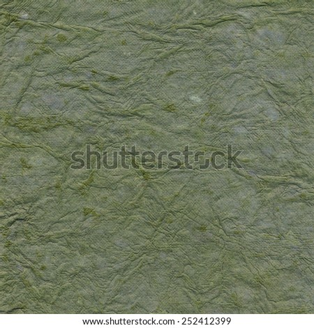 Green paper background with pattern - stock photo
