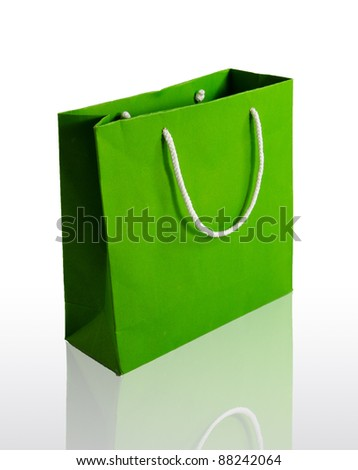 Green paper bag on reflect floor and white background - stock photo