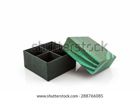 Green paper box on white background.