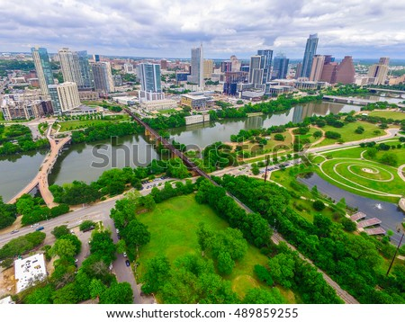 Green Paradise in Austin Texas Spring time bliss in central Texas Aerial View of the Capital City with Downtown Skyline north of the River and a green nature park south of the Colorado River