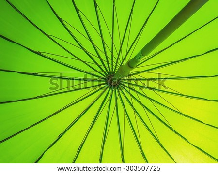 Green parasol. Parasol is an object like an umbrella for sun protection - stock photo
