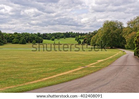 Green Park of Audley End House in Essex in England. It is a medieval county house. Now it is under protection of the English Heritage. - stock photo
