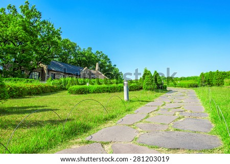 Green Park with stone pathway. - stock photo