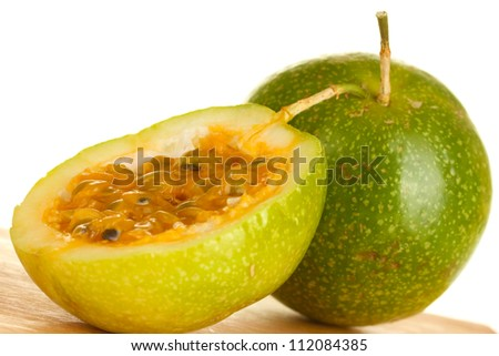 green passion fruit on white background close-up - stock photo