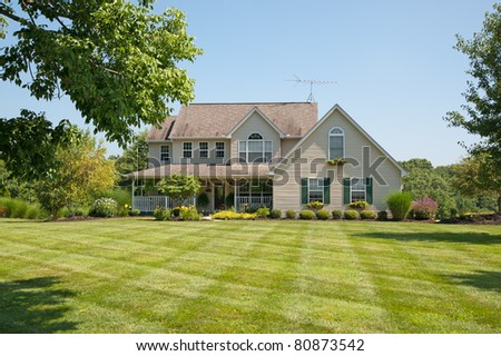Green pastures surround a farm house in Kentucky, USA. - stock photo