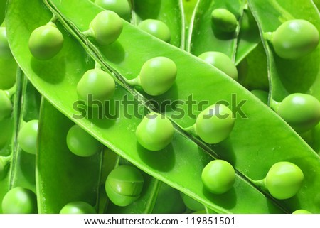 green pea pods isolated in white - stock photo