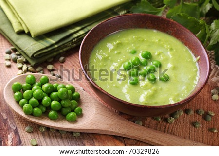 Green pea soup in bowl - stock photo