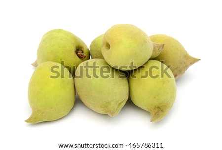 green peaches isolated on white
