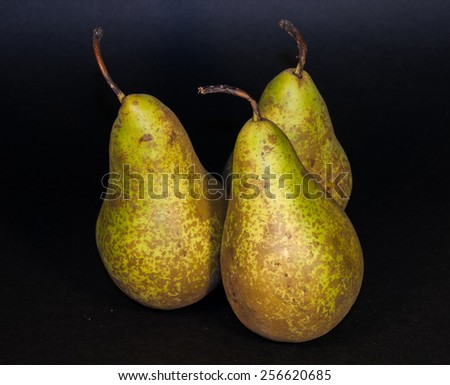 Green pears isolated from black background