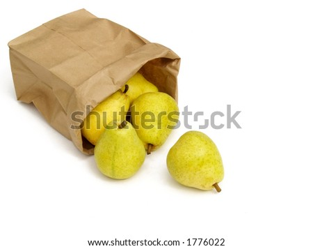 green pears tumbling out of a brown paper bag