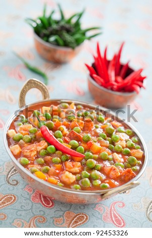 Green peas and paneer cheese in a spicy tomato sauce, selective focus - stock photo