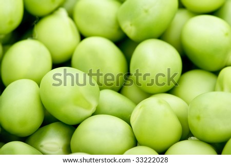 Green peas closeup. Shallow DOF. Focused on lower half of image