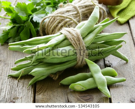 green peas on a wooden table, rustic style - stock photo