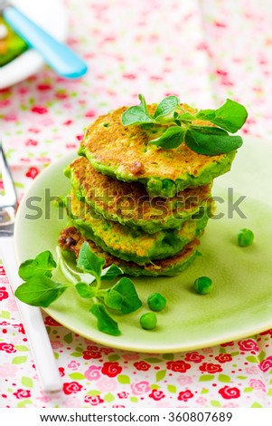 green peas pancakes with a smoked salmon and cheese feta.