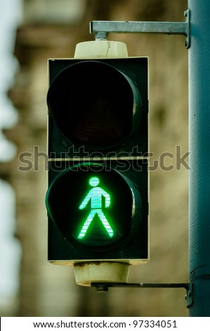 Green pedestrian lamp in the city