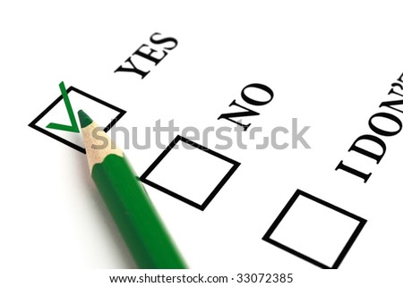 Green pencil and selected tick box. - stock photo