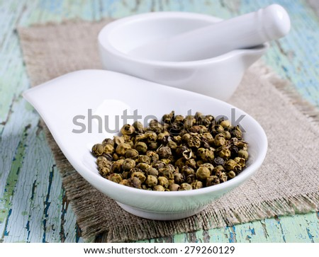 Green pepper in a ceramic dish on the sacking - stock photo