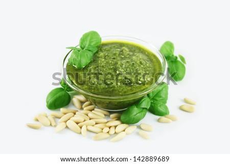 Green pesto sauce, pine nuts and basil - stock photo