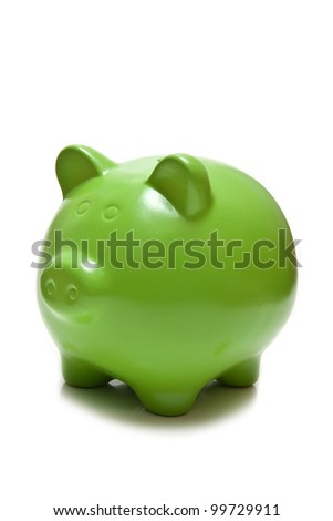 Green piggy bank or money box isolated on a white studio background. - stock photo