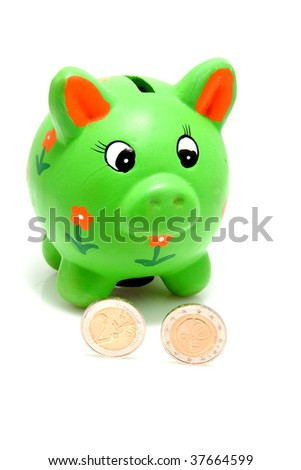 Green piggy bank with coins isolated on white background