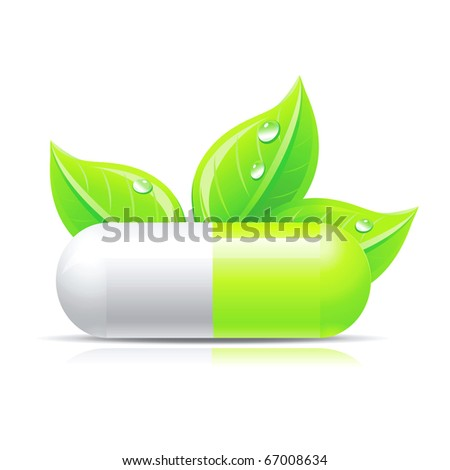Green pill isolated on white with leafs and droops. - stock photo
