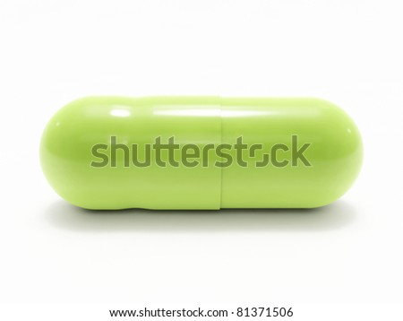 Green pill on white background, isolated - stock photo