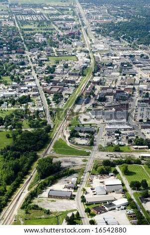 Green plains surround an interstate and small town. - stock photo