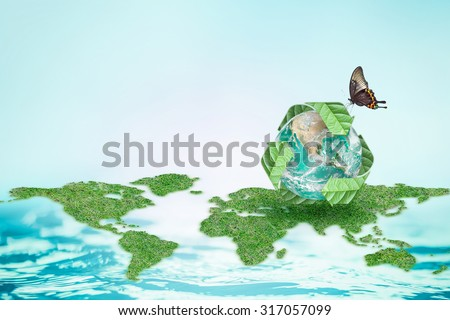 Green planet drinking butterfly & recycling arrow symbol on world map blurred natural clean blue water background: Renewable eco energy sources CSR concept: Elements of this image furnished by NASA   - stock photo