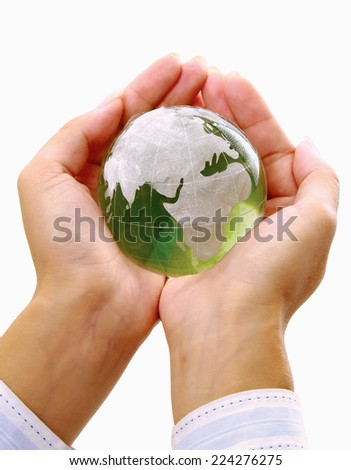 Green planet in women's hands.