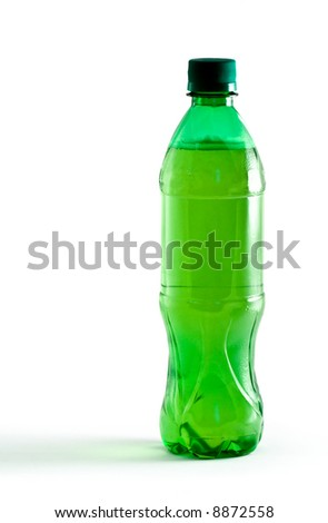 Green plastic bottle with a drink isolated on white - stock photo