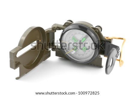 Green plastic compass isolated on white - stock photo