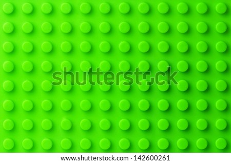 Green plastic construction background - stock photo