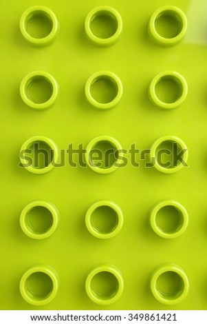 Green plastic construction baseplate, for backgrounds or textures - stock photo