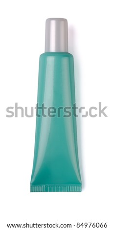 Green plastic cosmetic tube isolated on white - stock photo