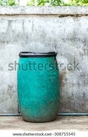 Green plastic dust bin background. - stock photo