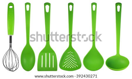 Green plastic kitchen utensils isolated on white. Clipping path included. - stock photo